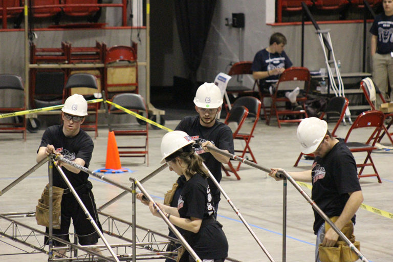 The UConn Steel bridge team assembling their bridge at the New England competition. Left to right are Kevin McMullen, Manal Tahhan, Dennis Gehring, and Richard Breitenbach. (photo courtesy of Francis McMullen)