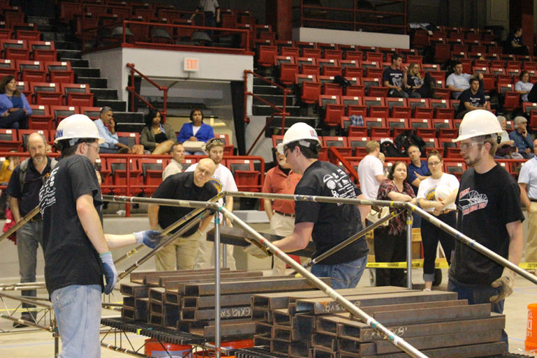 The team places 2,500 pounds on the bridge as part of the competition. From left are Richard Breitenbach, Clinit Cornacchia, and Dennis Gehring. (Photo courtesy of Francis McMullen)