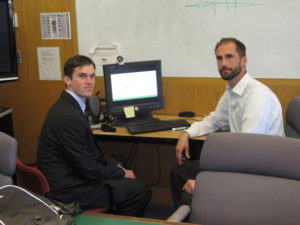 Master's student Brett Decker, left, and associate professor of civil and environmental engineering Nicholas Lownes have developed a model that can help Connecticut use its storm centers more efficiently – and also save money. (Josh Garvey/UConn Photo)