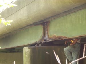 A bridge in Massachusetts, showing corrosion of a steel beam. (Photo courtesy of CME Engineering)