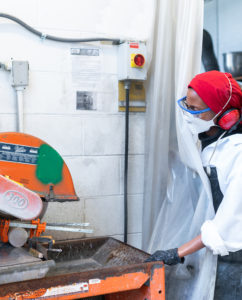 A person working inside the Advanced Cementitious Materials & Composites (ACMC) Laboratory