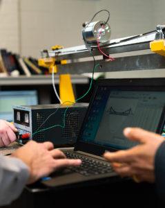 Laptop and other equipment inside the fiber optics sensor lab