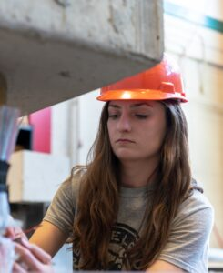 Structural Engineering student working hands-on on a project