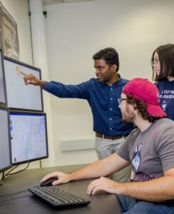 Professor working with two Transportation and Urban Engineering students