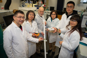 Team holds their sensors for SitS research project.