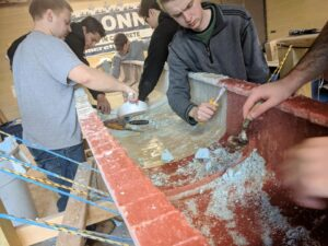 Concrete Canoe team building the canoe